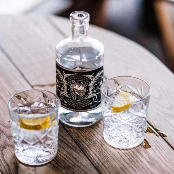 Lyme Bay gin with 2 cocktail glasses